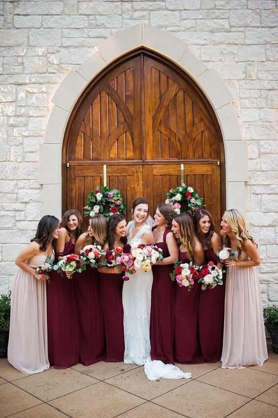 burgundy bridesmaids' dresses and blush gowns for the maids of honor