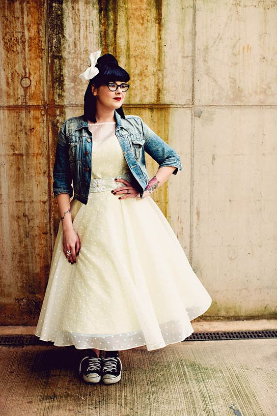 rock-n-roll bride in a polka dot dress, a denim jacket and black Converse