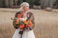 14 fur shawl is a fashionable touch to the bride's ensemble