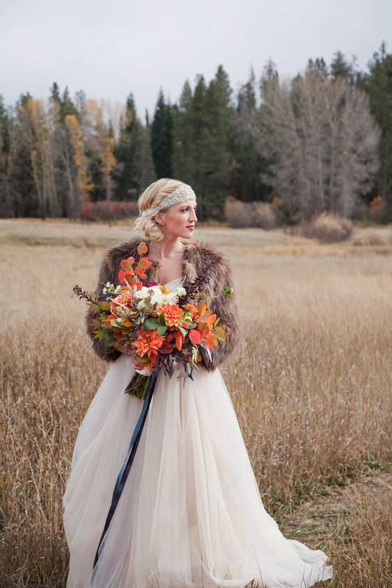 fur shawl is a fashionable touch to the bride's ensemble