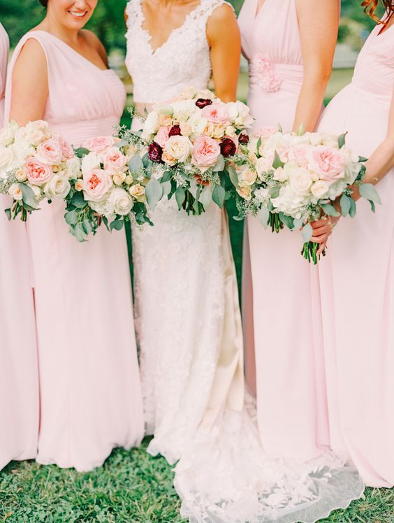 blush bridesmaids' gowns and bouquets, touches of burgundy for the bridal bouquet