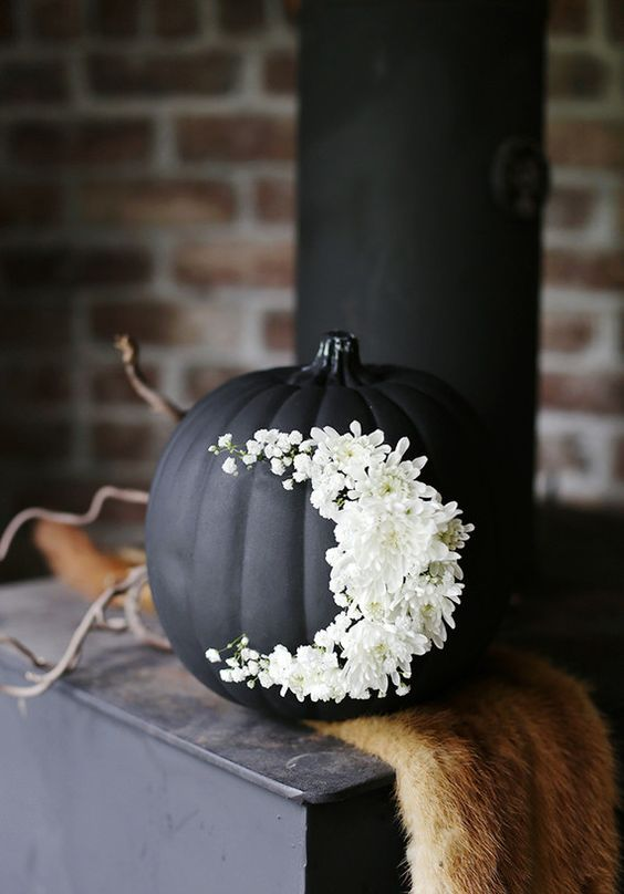 black pumpkin with moon shape white flower decor