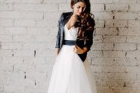16 tulle wedding dress with a black sash and a black jacket