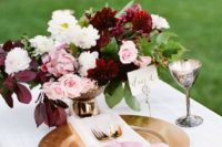 17 berry-hued and blush centerpiece, a blush ribbon that echoes it