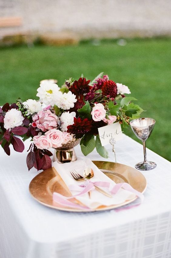 berry-hued and blush centerpiece, a blush ribbon that echoes it