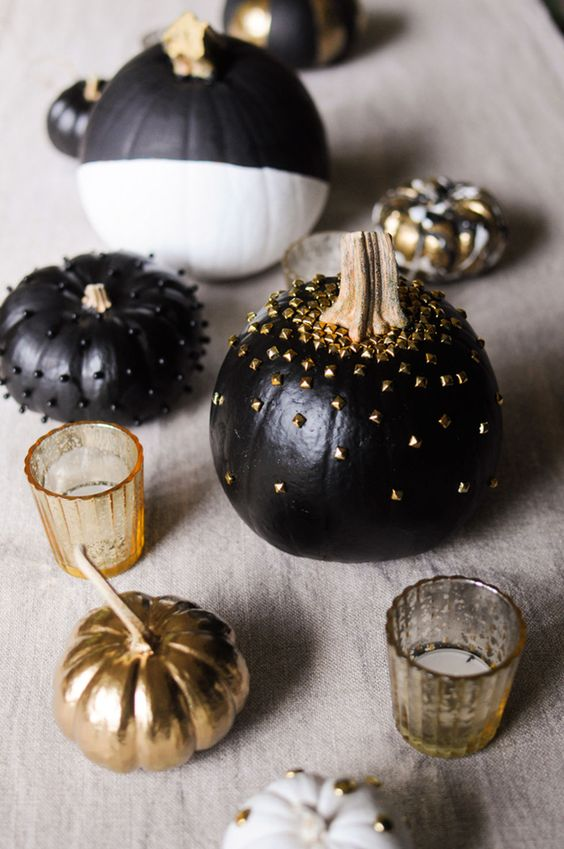 black pumpkins with black and gold metallic studs