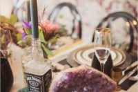20 rock wedding table with whiskey bottle candle holders and large geodes