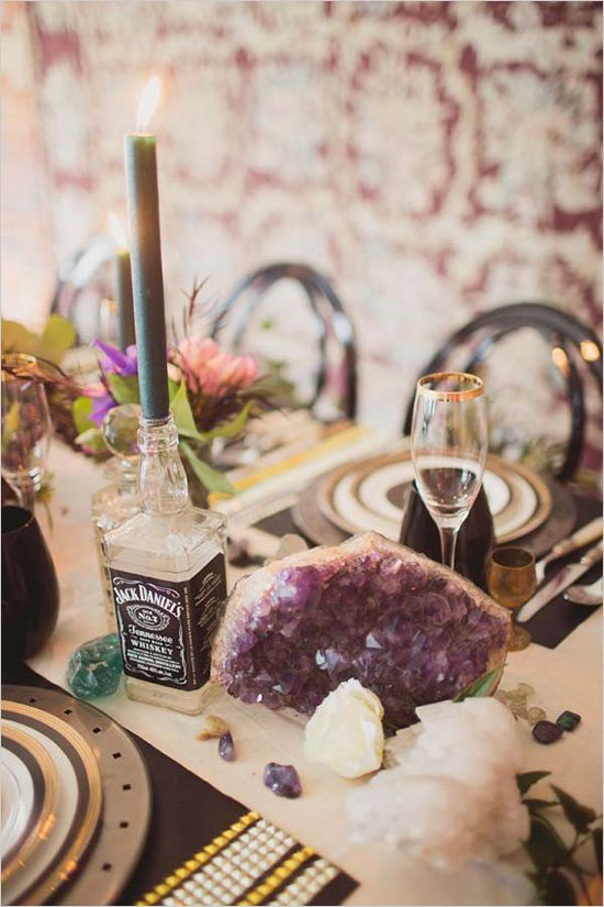 rock wedding table with whiskey bottle candle holders and large geodes