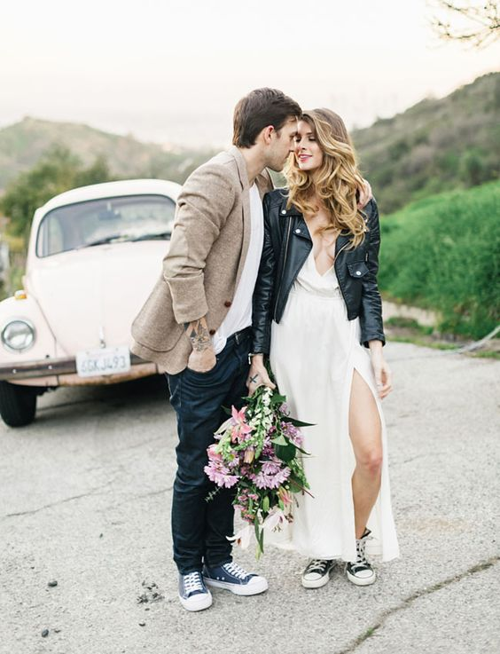 white plunging neckline wedding dress, Converse and a black jacket