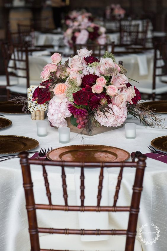 burgundy and blush floral centerpieces look very fall-like and lush