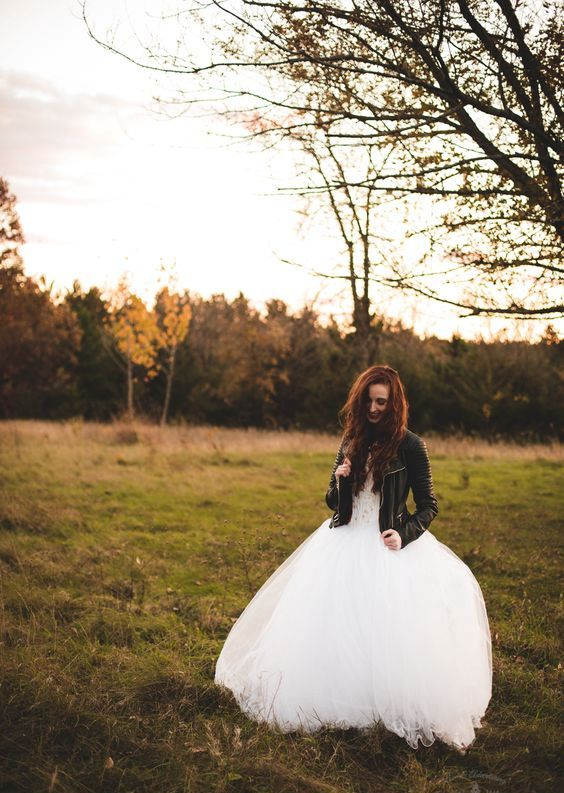 white tutu wedding dress wearing a leather jacket