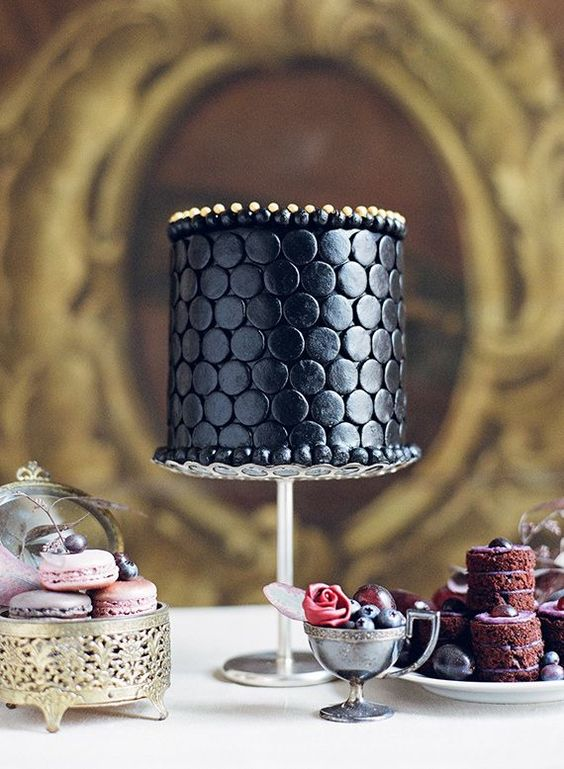 elegant black cake with gold decor