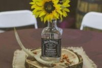 22 whiskey bottle vase for a centerpiece