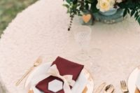 23 glam table setting with burgundy and blush details