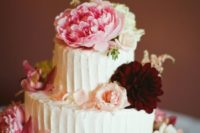 25 cake topped with beautiful pink peonies, roses, and burgundy dahlias