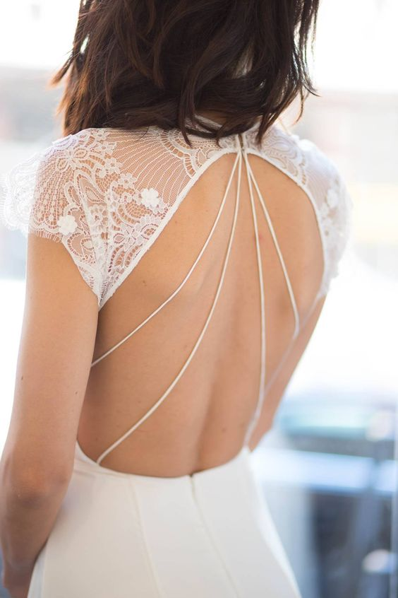 lace cap sleeved wedding dress with an open back