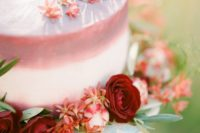 26 blush cake decorated with burgundy roses