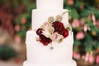 27 tiered whiite cake with burgundy and blush florals