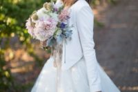 27 wedding ball gown with a cropped white leather jacket