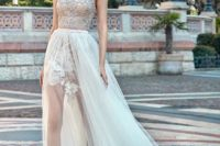 31 mini wedding dress under a long tulle skirt