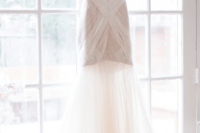 32 minimalist wedding dress with a long transparent skirt