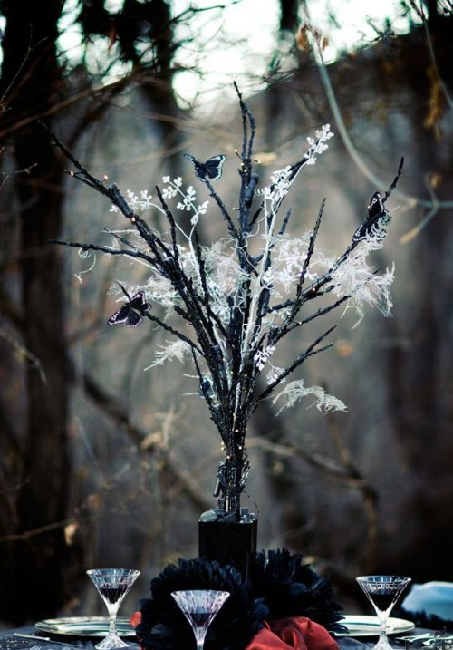 haunted centerpiece of branches and black butterflies