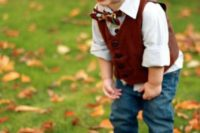 Adorable outfit with brown vest and cap, white shirt, jeans and printed bow tie