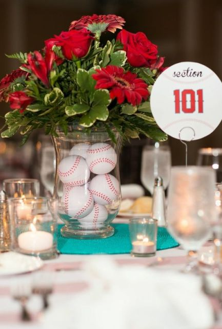 Baseball themed table centerpiece with red flowers