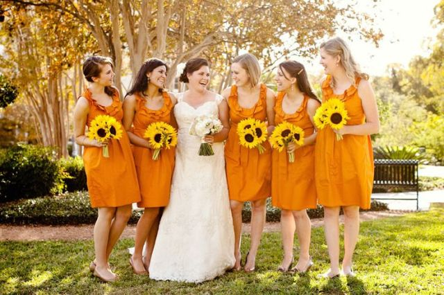 b6327bb0cecbf2 Bridesmaids looks with ruffle knee-length dresses, flats and sunflower  bouquets