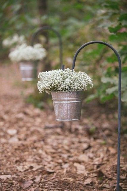 Buckets with baby breath flowers