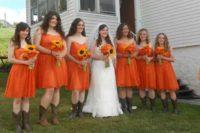 Cute knee-lendth orange dresses with cowboy boots