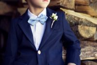 Elegant look with navy blue jacket, white shirt, light blue bow tie and beige pants