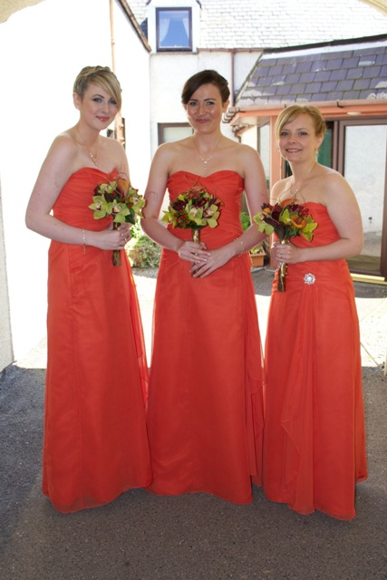 Simple but chic strapless maxi gowns with brooches