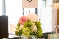 Simple table centerpiece with pastel color flowers