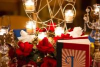 Table centerpiece with carousel candle holder and red roses