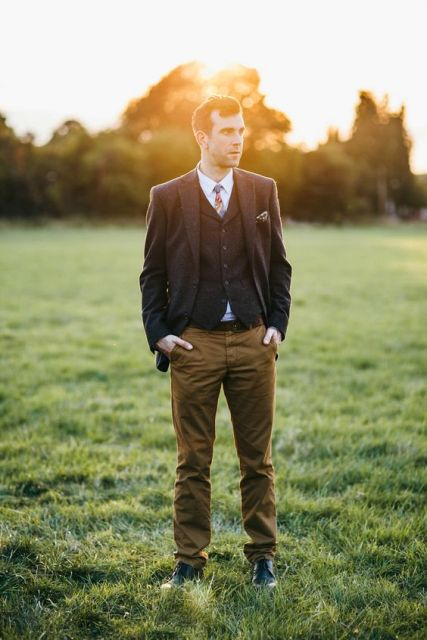 With colored tie and light brown pants