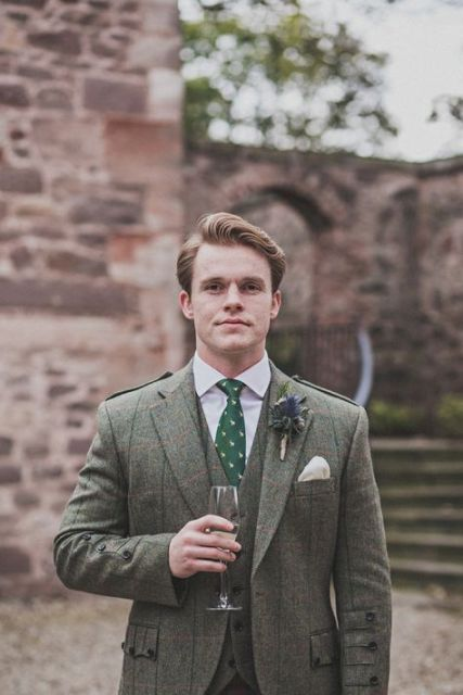 With tweed waistcoat, green tie with print