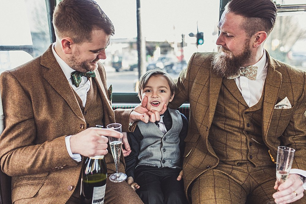 Picture Of stylish winter gay wedding with grooms in tweed 11