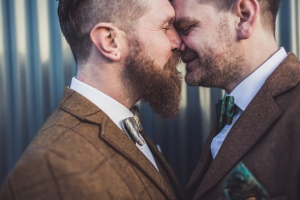 Picture Of stylish winter gay wedding with grooms in tweed 2