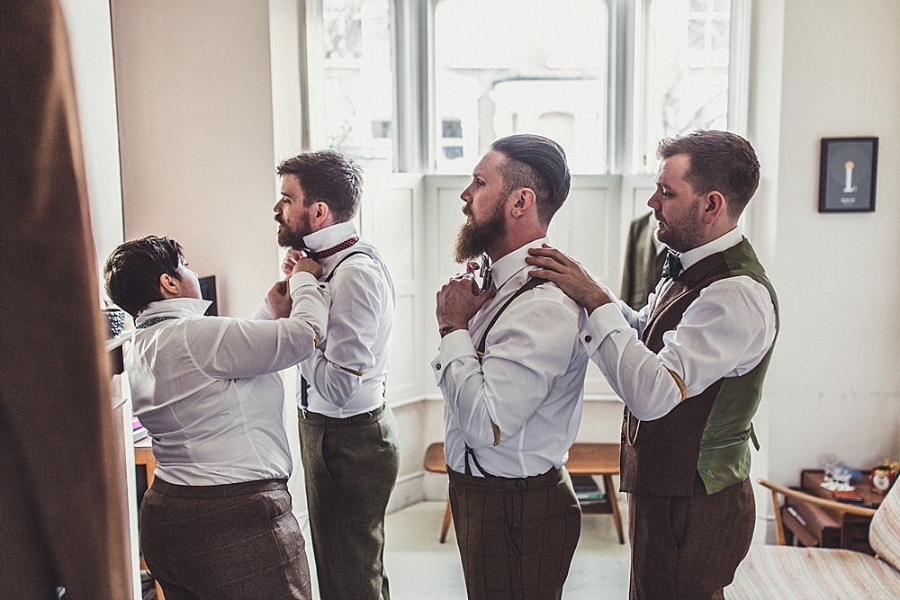Picture Of stylish winter gay wedding with grooms in tweed 4