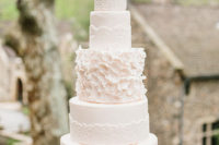 02 Fire-tiered lace wedding cake with a floral tier keeps the wedding theme perfectly