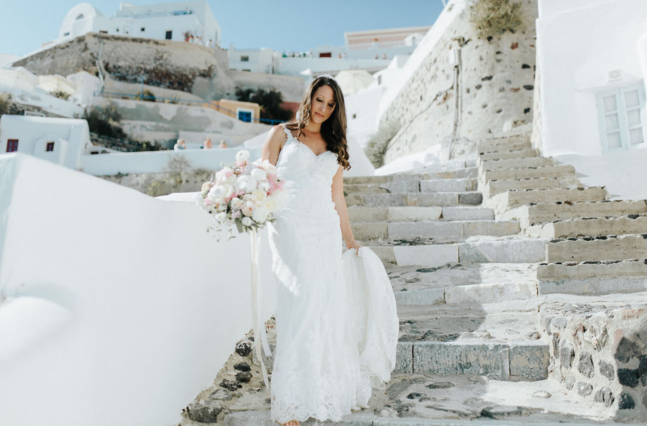 The bride was wearing a cool lace spagheti strap dress and a mantilla veil