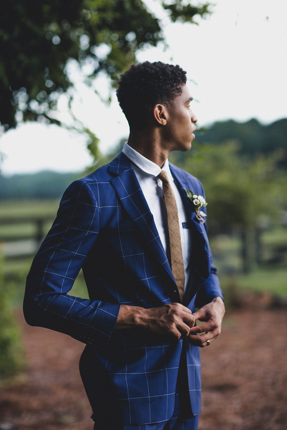 The groom was wearing a trendy checked blue suit and a delicate boutonniere