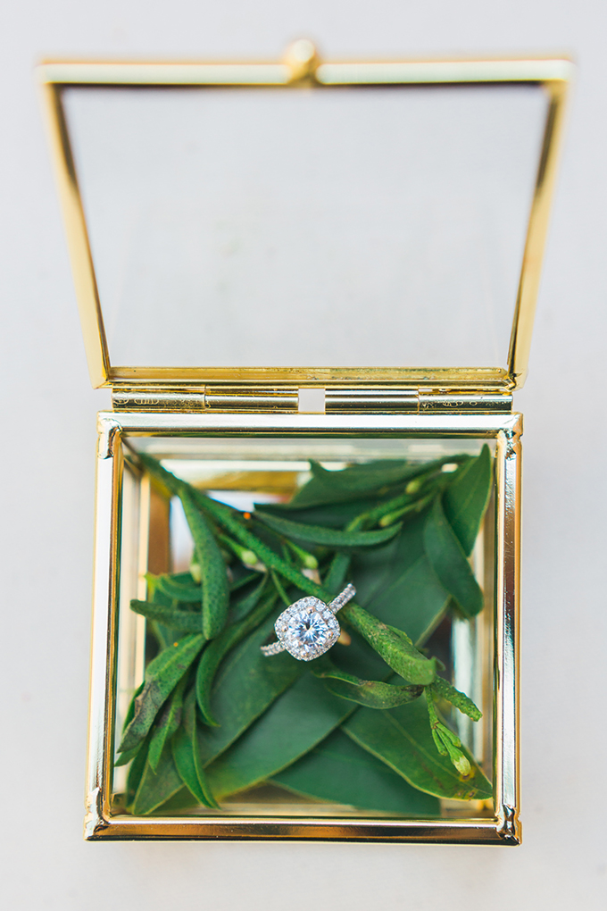 The ring box was a simple gilded glass one with greenery inside