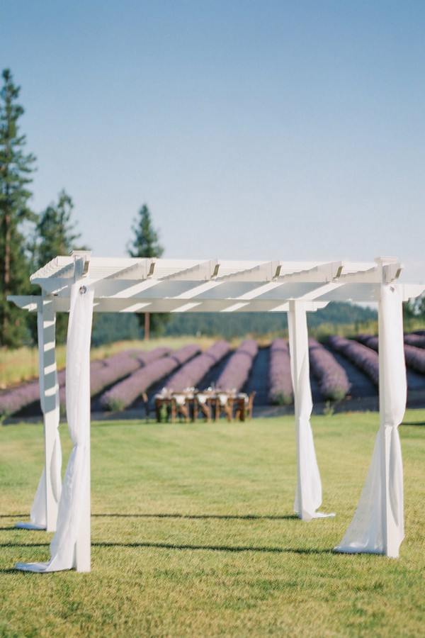 The wedding arch is simple, a wooden white with fabric