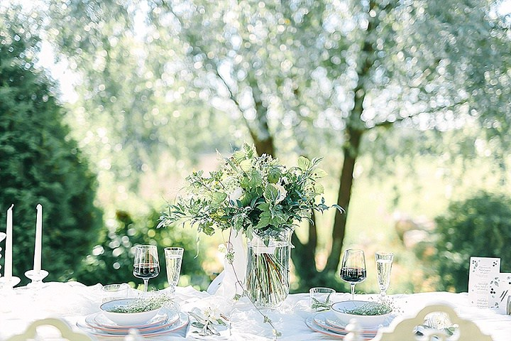 The wedding table setting was done in white, it's simple, with greenery and white flowers