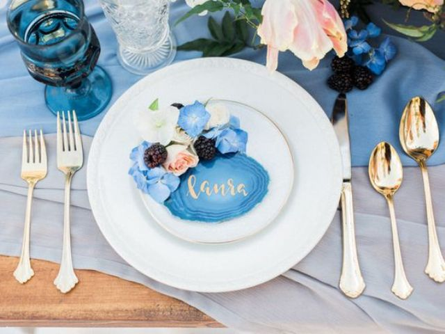agate place cards with gold calligraphy, blue flowers and blackberries