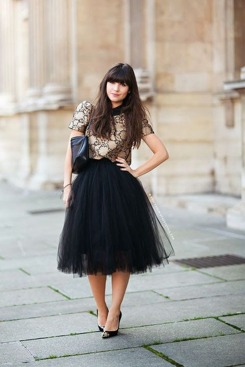 black tutu, a printed blouse and heels