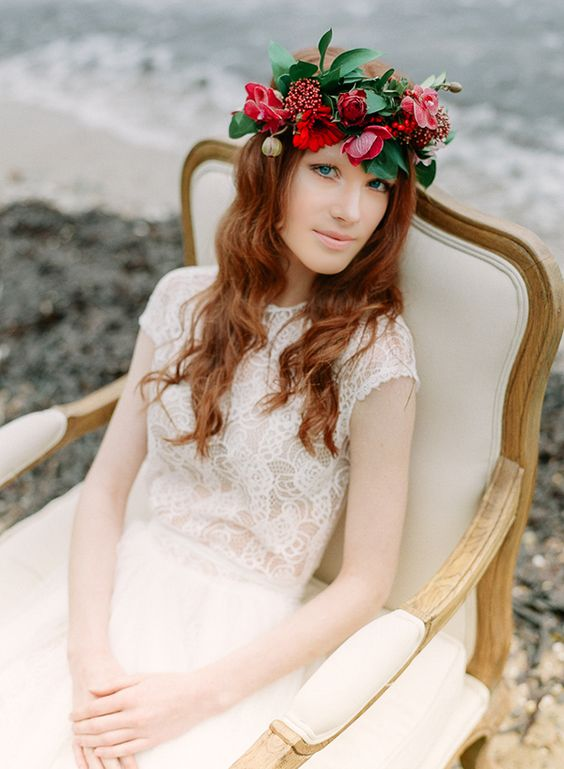 bold red flowers and green leaves crown for a statement bridal look