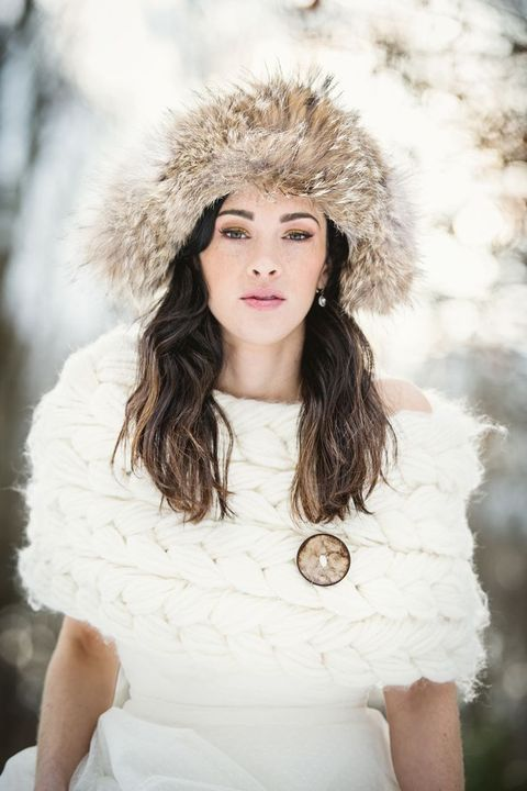 cozy knit cover up and a fur beanie will make your look outstanding